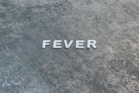 fever written out on gray background with white lettering