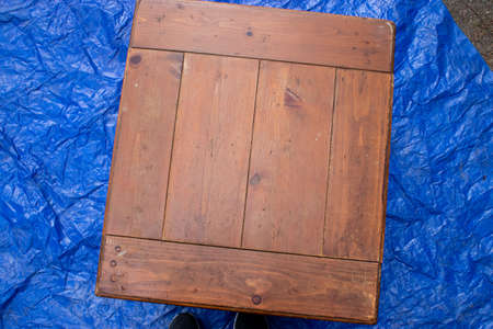 old antique table set out on a blue tarp Zdjęcie Seryjne