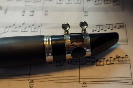 top side of clarinet on sheet music