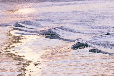 Puget sound waves around sunset with pastel light