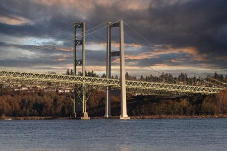 tacoma narrows bridge under dark storm clouds 스톡 콘텐츠