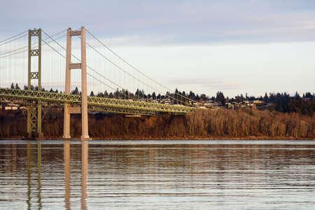 The Tacoma Narrows Bridge over calm reflective water Stock fotó