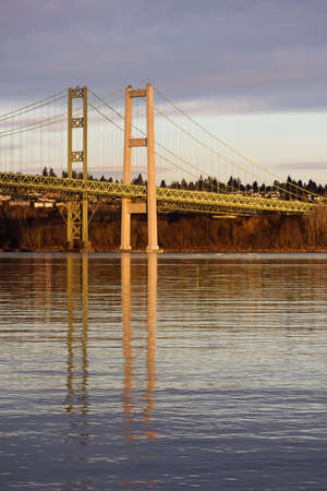 Tacoma Narrows over calm water under clouds