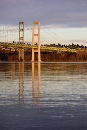 Tacoma Narrows mirrored in puget sound at sunset