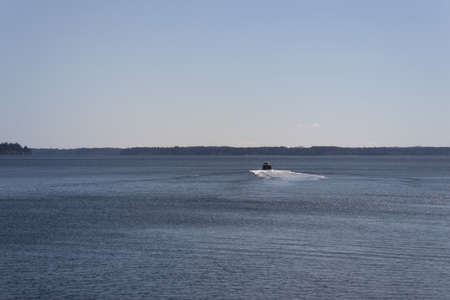 speed boat heading off away from the camera Фото со стока