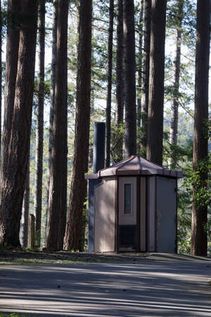 small shed for storage in the woods near path