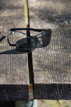 sunglasses in the sun on wood planks