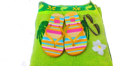Beach slippers,towel and sunglasses Stock Photo - 13817080