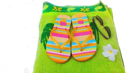 Beach slippers,towel and sunglasses Stock Photo - 13817080