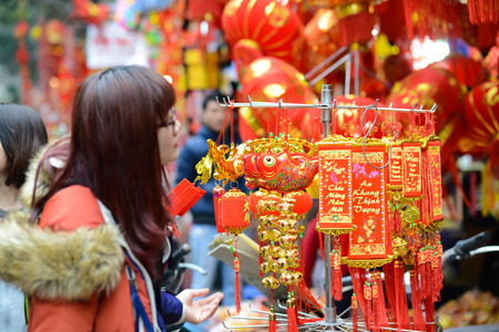 lucky charm: A Woman buy lucky charm for Lunar New Year event Editorial