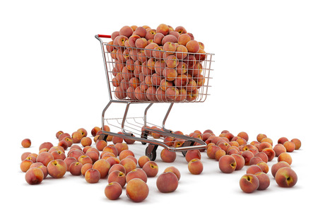Many peaches in a shopping cart on th white background Stock Photo