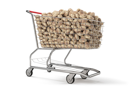 Many potatoes in a shopping cart on th white background