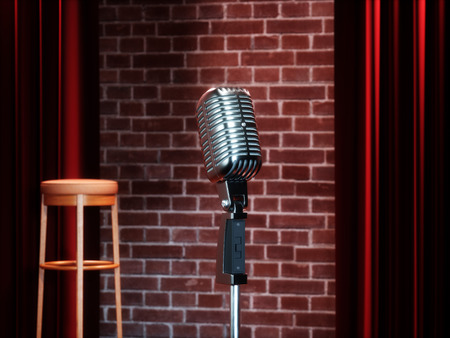 Vintage metal microphone against red curtain on empty theatre stage. 3D illustration Archivio Fotografico