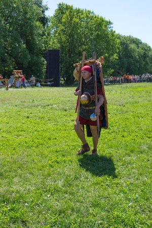 legionary: Roman legionary on the march. MOSCOW, RUSSIA - JUNE 7: Times and Epochs 2015 festival Ancient Rome, Kolomenskoye