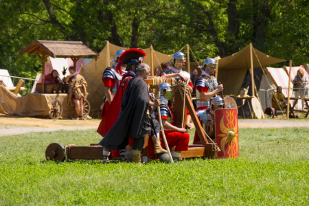 legionaries: Roman legionaries from a catapult. MOSCOW, RUSSIA - JUNE 7: Times and Epochs 2015 festival Ancient Rome, Kolomenskoye