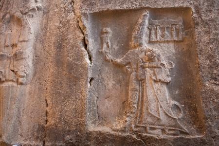 corum: King Tudhaliya is shown in the embrance of the god Sharuma, son of the storm god Teshup  Yazilikaya, Turkey