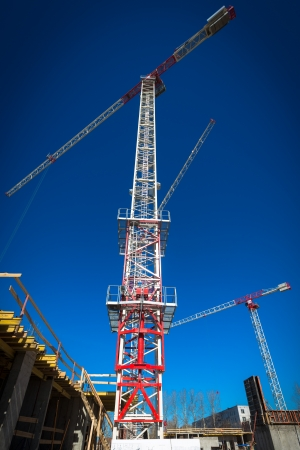 Construction site with cranes on sky background photo