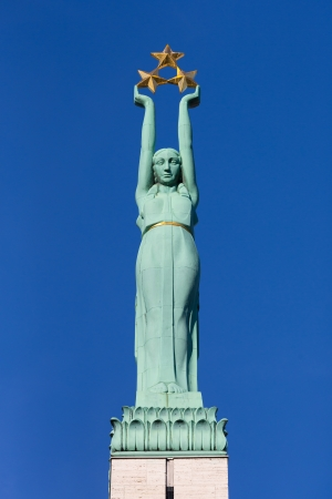 Freedom monument in Riga, Latvia with blue sky