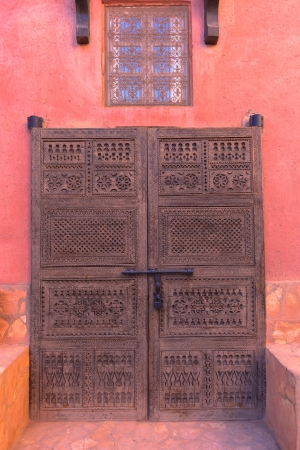 Ancient wooden carved door in the settlement of Ait Benhaddu. Morocco photo