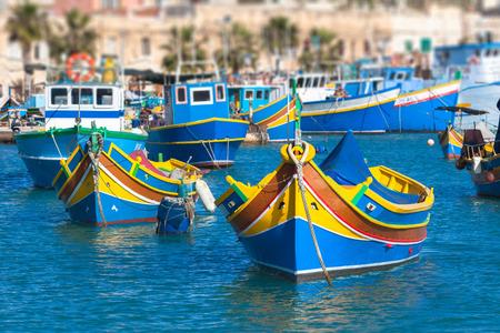 Colored Fishing boats in Marsaxlokk harbor, Malta photo