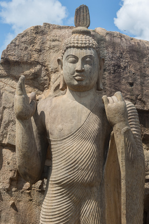 aukana buddha: Avukana standing Buddha statue, Sri Lanka. 40 feet (12 m) high, has been carved out of a large granite rock in the 5th century. Stock Photo