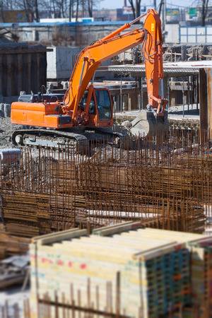piling: Excavator on a construction site Stock Photo