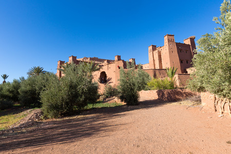 adobe wall: Ait Benhaddou, fortified city, kasbah or ksar, along the former caravan route between Sahara and Marrakesh in present day Morocco. It is situated in Souss Massa Draa on a hill along the Ounila River.