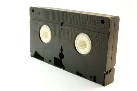 videocassette: Un video-cassette sobre fondo blanco Foto de archivo