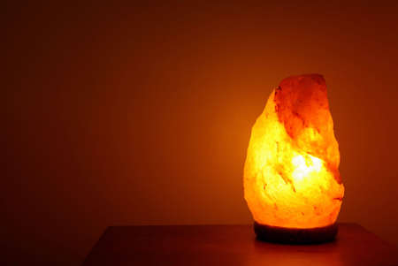 salt lamp: Crystal salt lamp lit in a room to make the atmosphere zen Stock Photo