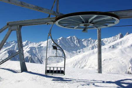 Typical empty ski gondola with a scenic background photo