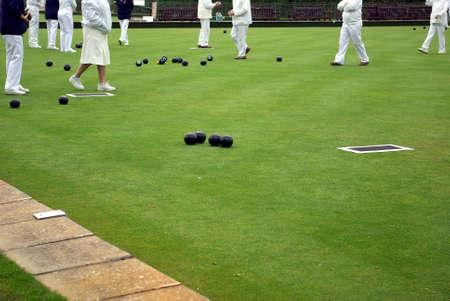 Senior people playing lawn bowling Stock Photo