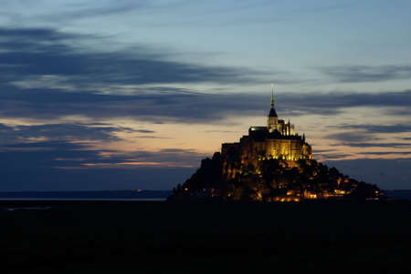 michel: Photo of Mont Saint Michel illuminated at sunset. Stock Photo