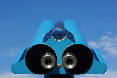 operated: Binoculars for observation over a blue sky.