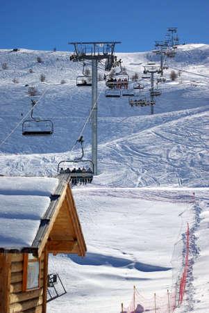 Vertical photo of gondolas in a skiing resort. photo