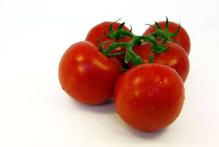 Close-up view on some fresh vine tomatoes photo