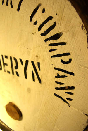 Close-up view on a barrel in a whisky distillery. photo