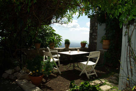 View of a nice patio overseeing the sea. Stock Photo