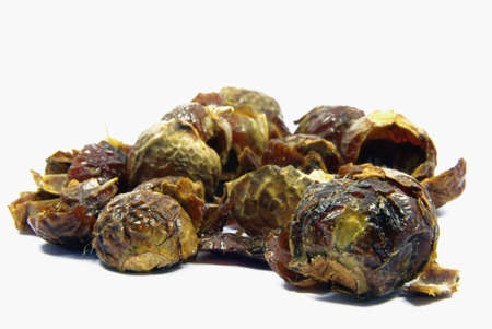Detail view of a bunch of soapnuts isolated.
