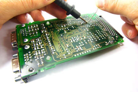 Detail view of a circuit board being repaired.