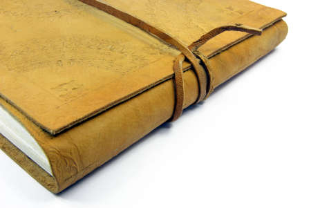 annotations: Detail view of a leather book over white background.