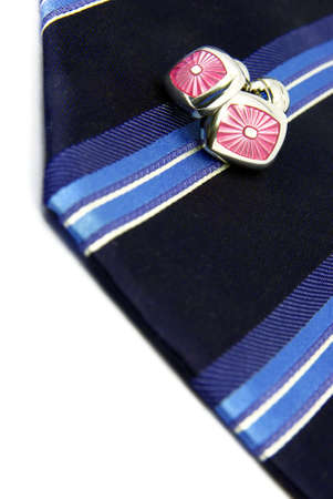 Detail view of fancy tie and cufflinks over white background. Stock Photo - 3823389