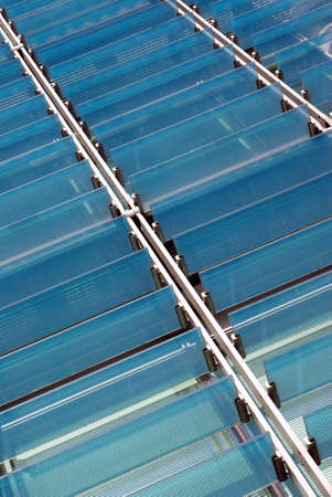 sunshades: Detail view of some glass sunshades of a modern building.