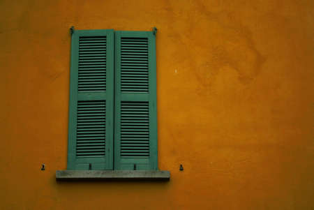 mediterranean home: Detail view of some shutters on a mediterranean house.