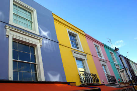 usual: View of some colourful houses in Notting Hill in London. Stock Photo