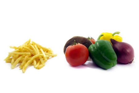 opting: View of some chips and vegetables over white background. Stock Photo