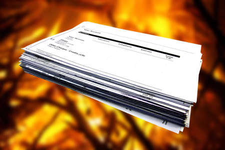 Isolated bills stack over a fire background photo