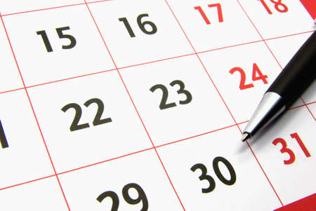 scheduling: Detail view of a typical calendar with a pen. Stock Photo