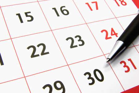 Detail view of a typical calendar with a pen. Standard-Bild