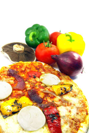 Studio shot of a pizza with the ingredients used. photo
