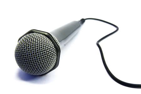 usual: View of an usual microphone isolated over a white background. Stock Photo